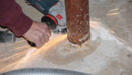 Cutting off Lally columns angle grinder
