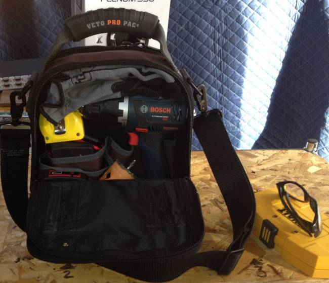The other side of the Veto Pro Pac MC stuffed with a variety of tools.