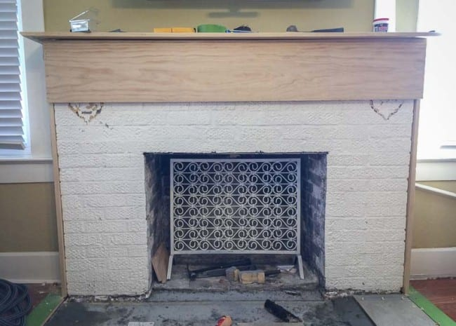 I have a 1923 craftsman style home with an ugly textured brick fireplace. I renovated with a tile over brick fireplace solution to dress it up a bit.