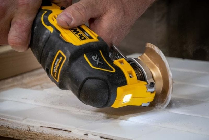 removing grout with DeWalt oscillating multitool